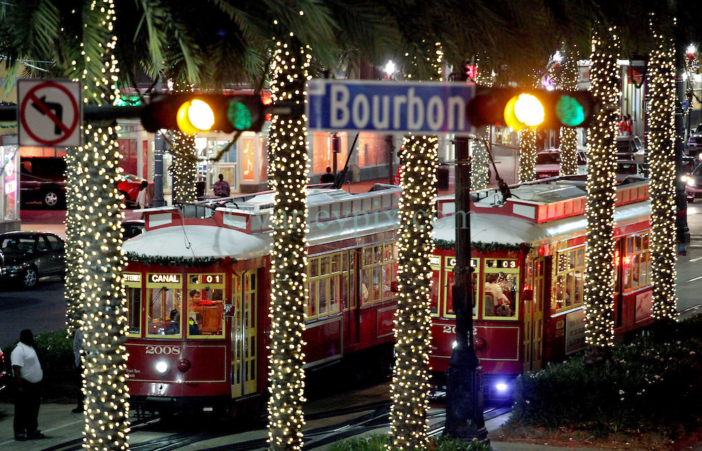 22 Nov 2011. New Orleans, Louisiana, USA.   Christmas lights on Canal Street as the street cars roll by disgorging tourists at the Bourbon and Royal Street stops. The lighting ceremony from the Astor Crowne Plaza. Photos; Charlie Varley